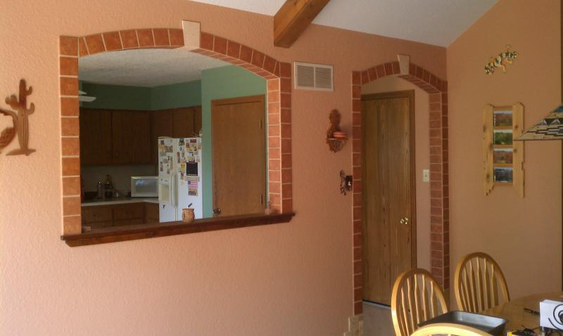 Add tile around a doorway and window opening for a dramatic effect!